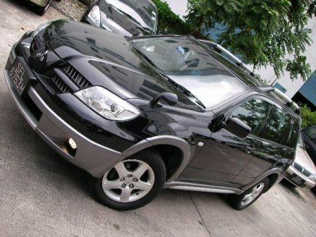 Mitsubishi Outlander 2004 - отзыв владельца