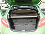 Багажник по объему вместительный, но загружать и выгружать сумки не очень удобно из-за высокого борта.