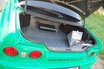 Багажное отделение Skyline не предполагает какого-то вызывающего Super custom — рифленый алюминий, усилитель и аккумулятор, не вместившийся в моторный отсек.