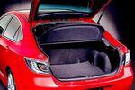 Автомобиль серии Sport c кузовом 5-дверного хэтчбэка. Если стоишь позади автомобиля с открытой дверью багажника, не составляет труда дотянуться до спинки заднего сидения. Тем не менее, по вместительности багажное отделение почти не уступает багажнику седана.