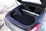 Сместив распорку жёсткости вперед, увеличили используемое пространство в багажнике.