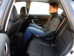 Subaru оказалась самым тесным кандидатом, поскольку высота ее салона небольшая. Но пассажирам на заднем сиденье места для ног достаточно.