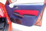 Дополнительный тахометр в специальном подиуме на водительской двери — ранее ничего подобного видеть не доводилось.