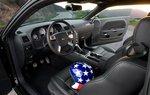 Простой салон соответствует ретроспективной эстетике Dodge.