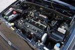 Под этим клубком из проводов прячется 1,5-литровый рядный четырехцилиндровый 91-сильный мотор CRX Si