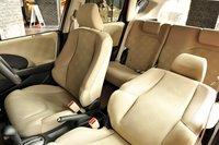 Салон базовой модели 13G. В комплектации F-package место водителя можно регулировать по высоте. Задние сидения, как и в моделях предыдущего поколения, можно складывать и полностью опускать. Багажное отделение топовых моделей увеличено на 1200мм. Заднее сидение оснащено двухточечным средним ремнем безопасности. Боковые подушки и шторки безопасности являются опциональными для топовых моделей, что еще раз заставляет задуматься об уровне безопасности автомобиля.