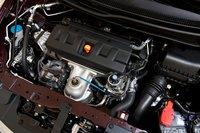 Одновальный 1,8-литровый рядный четырехцилиндровый мотор взят у Civic 2010. Этот легкий «на подъем» двигатель работает исключительно плавно. Но нам все же хотелось получить больше тяги на низах.