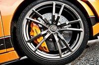 У Superleggera серьезные тормоза и не менее серьезные колеса.