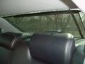 Собственный электропривод имеет даже солнцезащитная шторка за задним диваном
