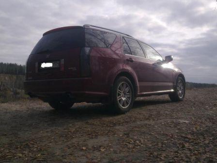 Cadillac SRX 2005 - отзыв владельца
