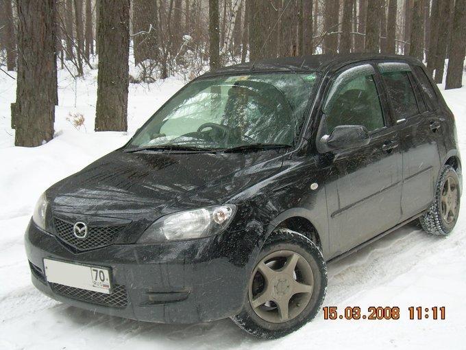 сравнение mazda demio 2003 и рено логан 2006 для такси
