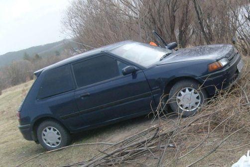 Mazda Familia 1992 - отзыв владельца