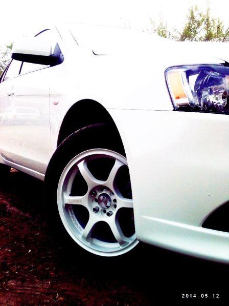 Mitsubishi Lancer 2013 - отзыв владельца