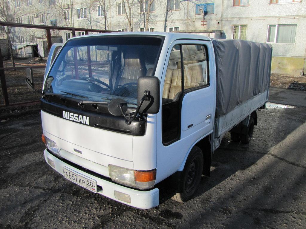 грузовик nissan тыга