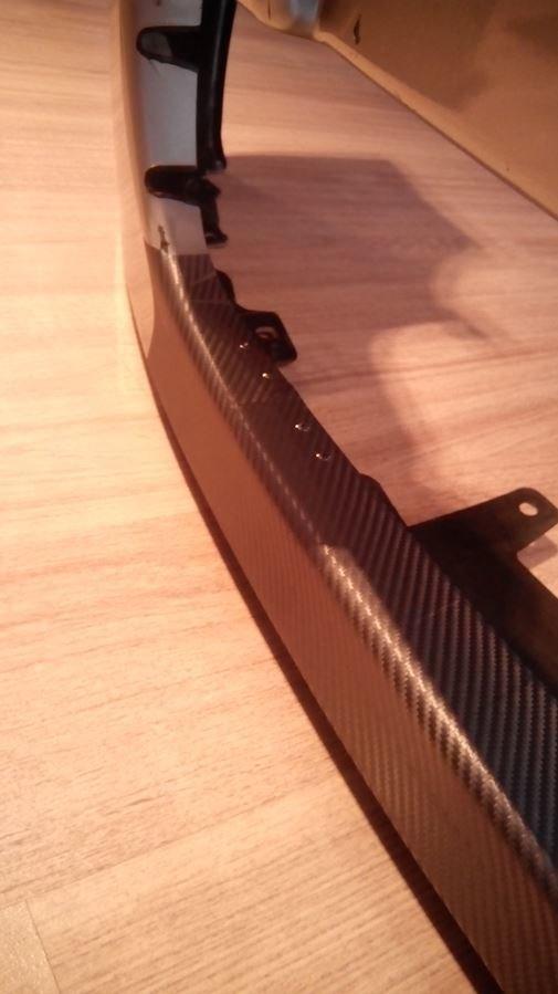 Оклеил отремонтированную часть винилом, здесь же видны клепки - с внутренней стороны приклепана металлическая шина для жесткости.