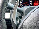 «Уши» на рулевой колонке Infiniti G37S: правое переключает передачу вверх, левое – вниз. Комбинация приборов двигается вместе с рулем.
