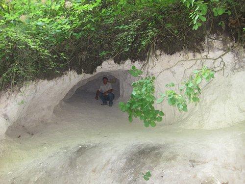 В небольшой пещере.