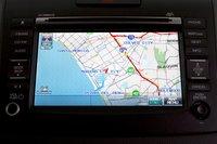 Система навигации CR-V выводит информацию о дорожном движении, но нам больше понравилась система Escape, простая и понятная.