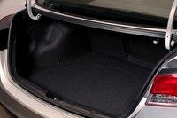 Складывающаяся спинка заднего сидения открывает массу возможностей для перевозки вещей.